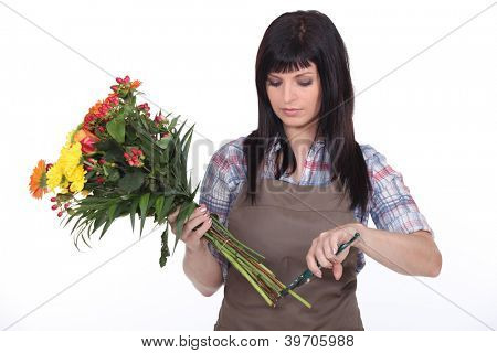 Florist cutting stems off flowers