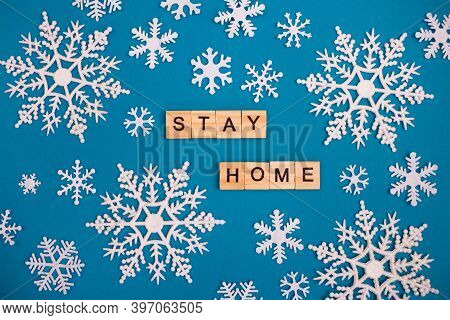 Letters Stay At Home On A Blue Background With Snowflakes. Coronavirus Protection Concept. Save You