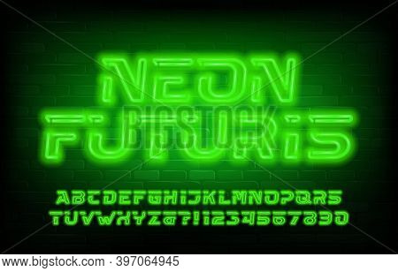 Neon Futuris Alphabet Font. Green Neon Futuristic Letters And Numbers. Brick Wall Background. Stock