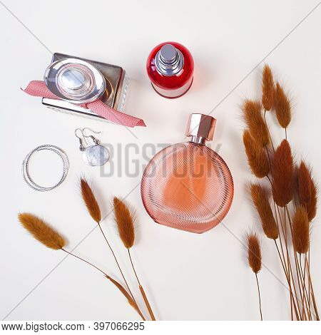 Perfume Bottles And Brown Herbs Lagurus. Flatlay, Top View, Lifestyle