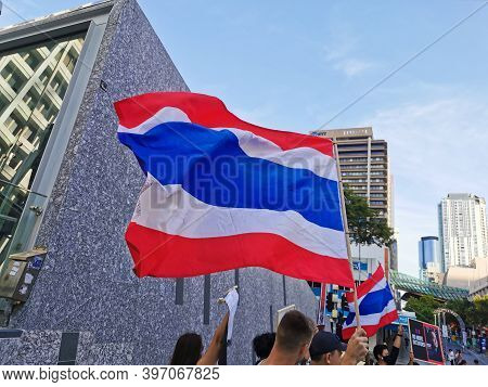 Brisbane, Australia - November 29, 2020: Group Of Protestors Shows Thailand National Flag While Peac