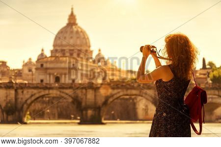 Girl Tourist Takes Photo Of St Peter's Basilica, Rome, Italy, Europe. Young Pretty Woman In Rome On
