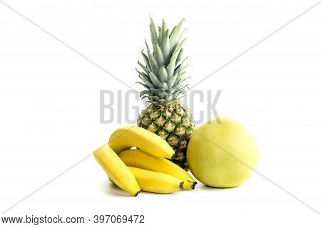 Yellow, Ripe, Large Fruit Pomelo (citrus Maxima), Pineapple And Bananas On White Background Close-up