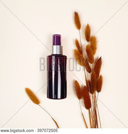 Mock-up Of Unbranded Brown Plastic Spray Bottle Brown Herbs On Ivory Table. Top View, Flatlay, Mocku