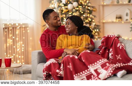 Home Comfort And Free Time In New Year And Christmas Together. Happy Young African American Lovers M