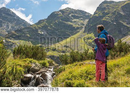 Father And Son Travel Hiking In Mountains, Family Tourism, Tatra Mountains National Park In Zakopane