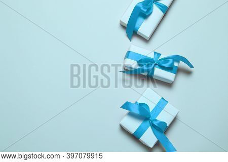Gift Packing Boxes, Blue Ribbon Bow, Candy On Stick, Stars Decor, Alarm Clock, House On A Blue Backg