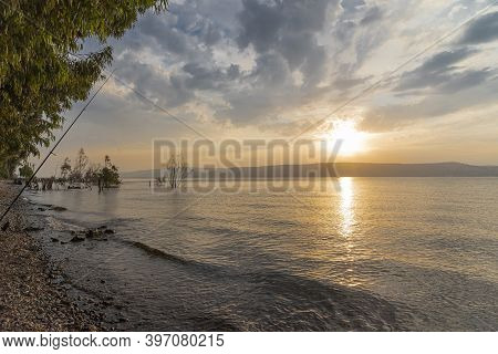 Sunset Over The Sea Of Galilee And Golan Heights. High Quality Photo.