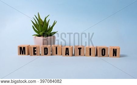 Mediation Word In Wooden Cube On Blue
