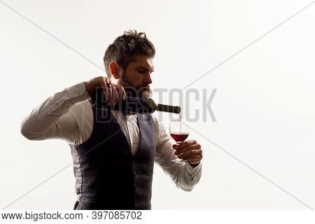 Man With Bottle Of Wine. Red Wine. Bearded Man With Alcohol. Man In Suit Drinks Wine. Alcohol. Wine.