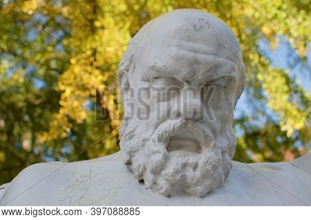 Close Up View Of Socrates Dying Resin Statue Located Inside The Parco Ciani Park In Lugano, Switzerl