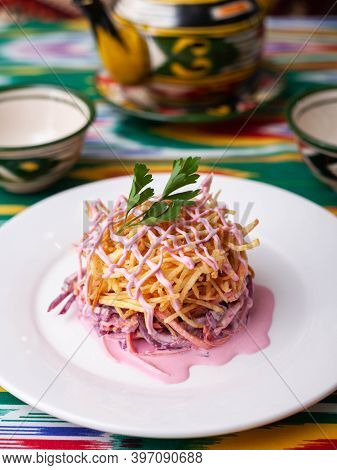 Capercaillie Nest Salad Made Of Beets, Pie Potatoes, Markovi And Greens, Topped With Mayonnaise. Asi