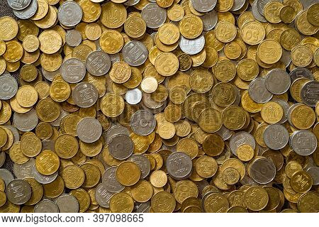 Plenty Of Golden And Silver Coins. Copper Coins, Quarters, Nickels. Money, Financial Coins And Econo