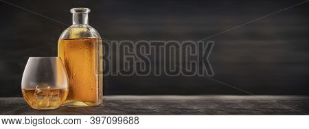 Advertising For The Bars Website - A Bottle And Glass On The Table With Scotch, Bourbon Or Whiskey.
