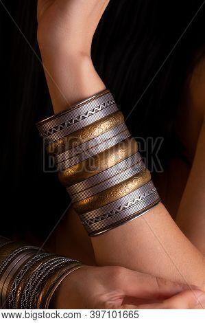 Wide Gold Bracelet On The Girl's Hands. National Indian Gold Bracelet.