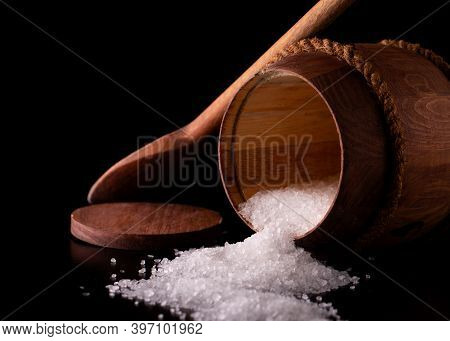 Salt In A Barrel Close-up. Sprinkled Sea Salt. Barrel Of Salt On A Black Background.