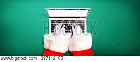 Santa Claus Using A Laptop Computer From Above