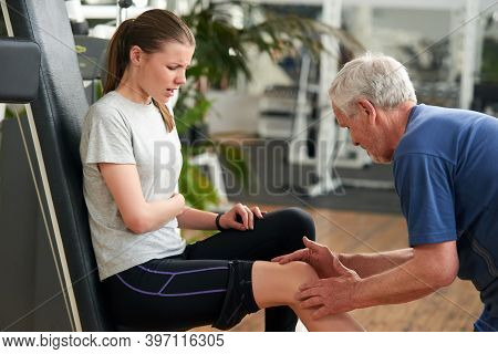 Fit Young Woman Having Knee Pain At Gym. How To Help Reduce The Risk Of Personal Injury During Fitne