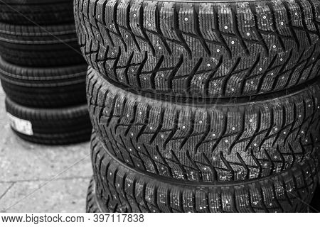 A Set Of Studded New Winter Tires In A Car Repair Shop