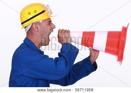 Tradesman screaming into a pylon