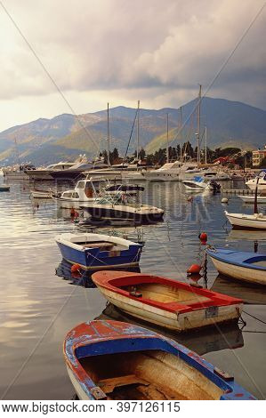 Cloudy Autumn Day. Mediterranean Landscape With Fishing Boats On Water. Montenegro, View Of Kotor Ba