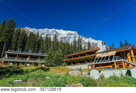 A Small Lodge On The Moraine Lake Lakeshore In Summer Sunny Day.