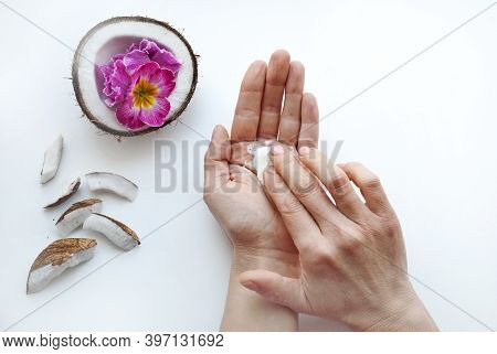 Woman Smears Her Hands With Natural Cream. Female Hands Close-up Top View. Organic Cosmetics With Co