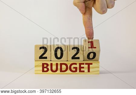 Business Concept Of Budget Planning 2021. Male Hand Flips Wooden Cube And Changes The Inscription 'b