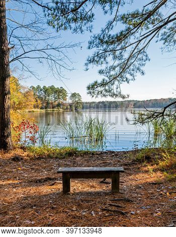 Beautiful view of a lake with focus on bench in foreground