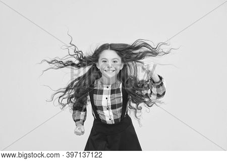Air In Her Hair. Natural Beauty. Child With Natural Beautiful Healthy Hair Yellow Background. Tips F