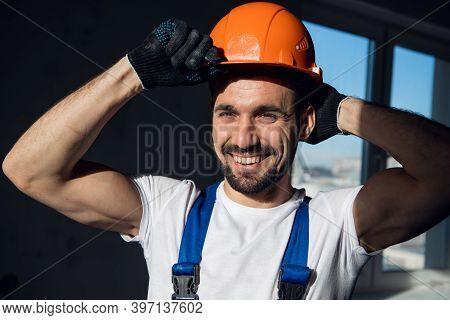 A Bearded Foreman Straightens A Construction Helmet On His Head