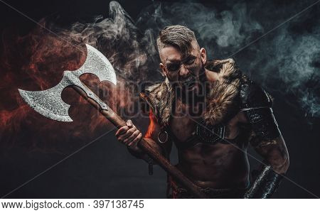 Armed With Two Handed Axe Savage And Screaming Viking In Fur With Armour In Dark Background With Smo