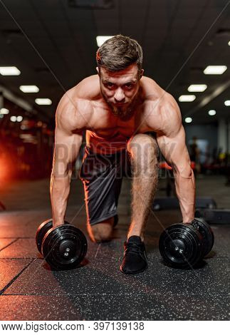 Brutal Strong Athletic Men Pumping Up Muscles. Doing Workout On Sport Equipment. Muscular Bodybuilde