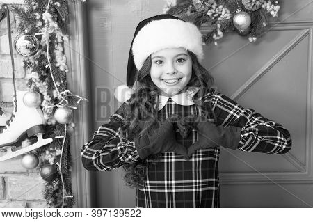 Cheerful Girl In Santa Claus Hat And Gloves. Winter Holiday Activity. Season Shopping. Last Preparat