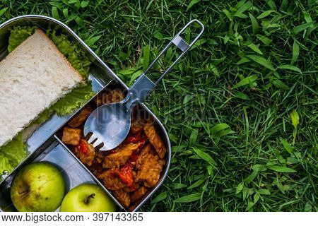 Stainless Steel Container Or Lunch Box With Healthy Vegetarian Meal And Reusable Thermo Bottle On Gr