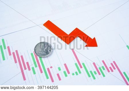One Rouble Coin On Currency Graph With Red Arrow Down. Exchange Rate Chart. Ruble Depreciation. Exch