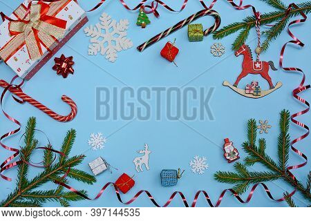 Christmas Circular Layout On A Blue Background. Christmas Toys, Serpentine, Gift Boxes, Snowflakes,