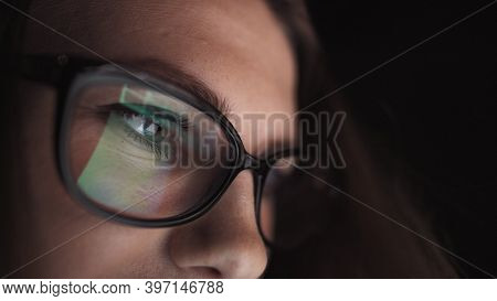 Attractive Young Businesswoman Working At Night Via Computer At Office With, Closeup Of Hipster Stud