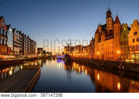 Motlawa River And Beautiful Old Architecture Of Gdansk At Night. Poland