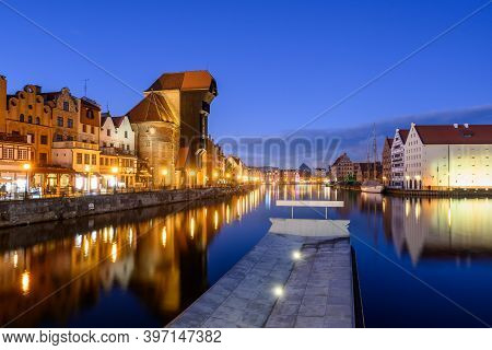 Motlawa River And Beautiful Historic Architecture Of Gdansk At Night. Poland