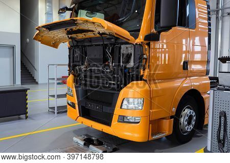 Service Maintenance Of Trucks. Truck Under Repair At A Service Station. Car Repair And Inspection, C
