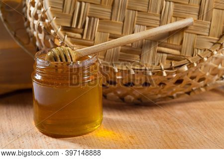 A Jar Of Honey With A Wooden Ladle On A Wooden Table. Organic Honey, Healthy Food