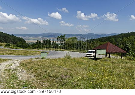 Rila Mountain, Bulgaria - August 04, 2014: Green Forest, Road, Alcove And Flower Meadows In Rila Mou