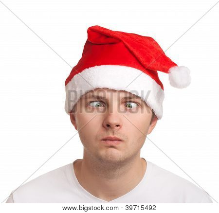 Young man in santa hat with crossed eyes