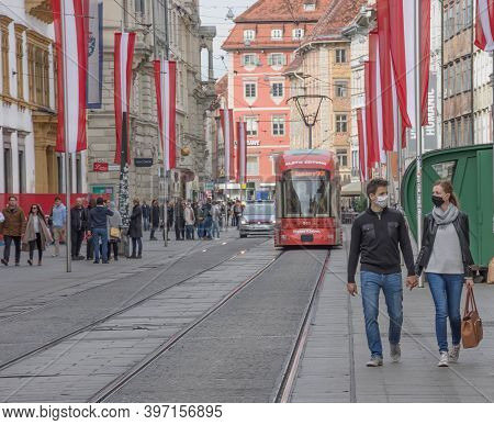 Graz, Austria-october 26, 2020: People On Famous Herrengasse Street Wearing Face Masks For Protectio