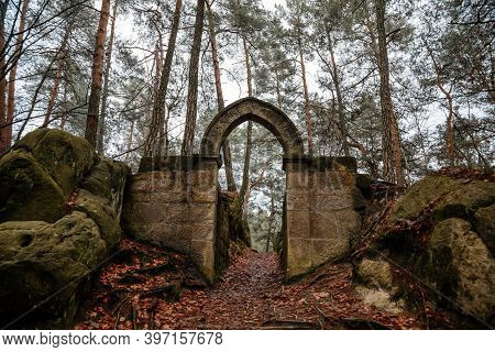 Stone Arch Fairytale Portal With Autumn Leaves, Vranov Castle Gothic Ruins With Pantheon On Steep Sa