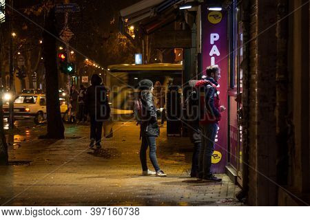 Novi Sad, Serbia - March 13, 2016: People, Youngsters, Waiting At Night In Front Of A Fast Food Rest