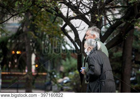 Belgrade, Serbia - November 8, 2020: Old Senior Man And Woman, Couple, Wearing A Respiratory Face Ma