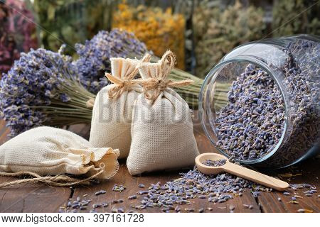 Glass Jar Of Dry Lavender Flowers, Sachets, Bunches Of Dry Lavender. Jars Of Different Dry Medicinal