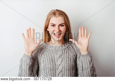 Confused Shy Clueless Woman Looking At Camera With Open Arms. Refusal, Awkwardness, Tension Concept